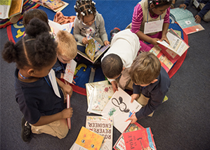 "Kindergarteners at the Lea School excitedly read new books given through ""A Book A Day."""