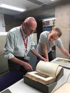 Museum staff with rare books